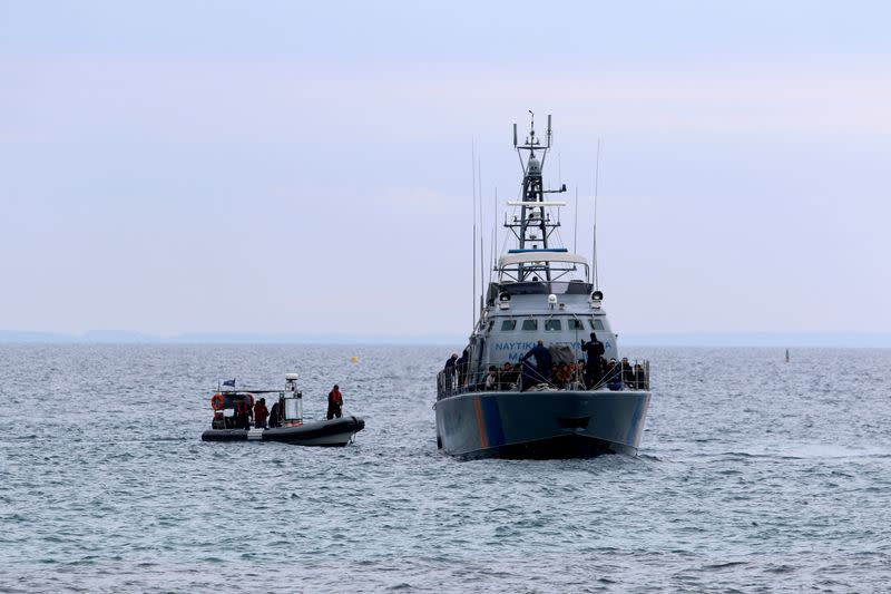 FILE PHOTO: Syrian refugees arrive on a Cyprus coast guard boat to the south-east of the island in the region of Protaras