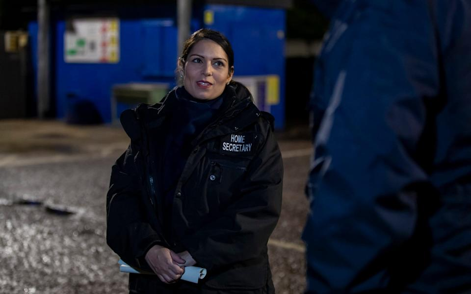 Home Secretary Priti Patel accompanied Immigration Enforcement Officers on an early morning arrest in north London of a suspected suspected of having a significant financial role in an organised crime group linked to people smuggling activity - Heathcliff O'Malley
