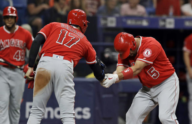 Los Angeles Angels' Albert Pujols (5) bows as he shakes hands with Shohei Ohtani (17), of Japan, after Pujols hit a two-run home run off Tampa Bay Rays' Ryan Yarbrough during the fifth inning of a baseball game Thursday, June 13, 2019, in St. Petersburg, Fla. (AP Photo/Chris O'Meara)