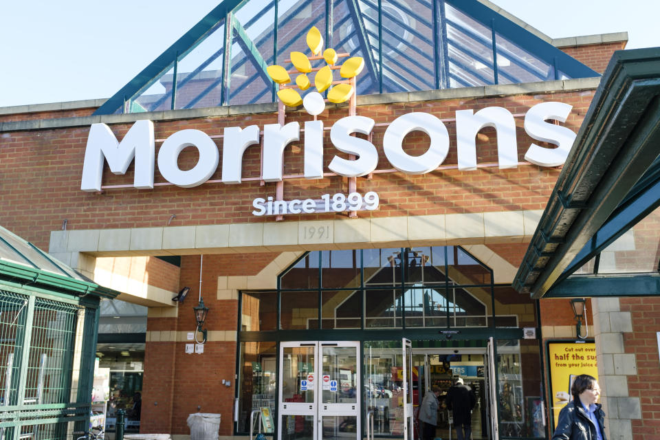 Shoppers outside the front of a Morrisons store in Hatch End, London. WM Morrison is the UK fourth largest chain of supermarkets