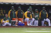 Oakland Athletics watch from the dugout during the sixth inning of the team's baseball game against the Los Angeles Dodgers in Oakland, Calif., Tuesday, April 6, 2021. (AP Photo/Jed Jacobsohn)