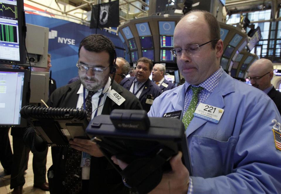<p> In this May 11, 2012, photo, trader Peter Mancuso, right, works on the floor of the New York Stock Exchange. U.S. stocks were set for a moderately higher opening Thursday May 17, 2012, with Dow Jones industrial futures up 0.3 percentand S&P 500 futures up 0.4 percent. (AP Photo/Richard Drew) </p>