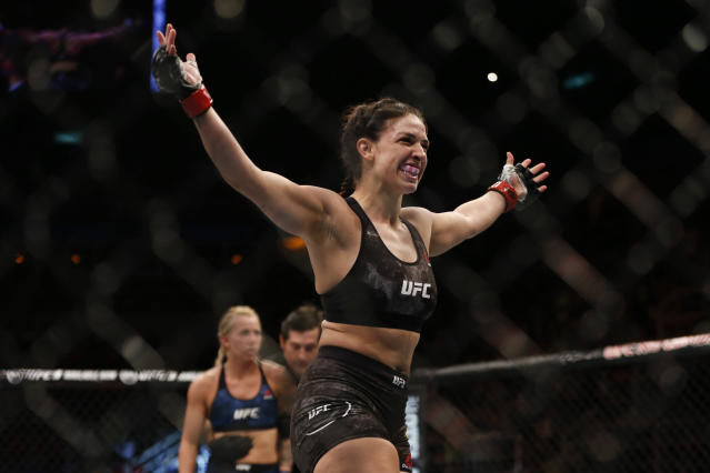 Mackenzie Dern, from the United States, celebrates after defeating countrywoman Amanda Cooper during their UFC women's strawweight mixed martial arts bout in Rio de Janeiro, Brazil, early Sunday, May 13, 2018. (AP Photo/Leo Correa)