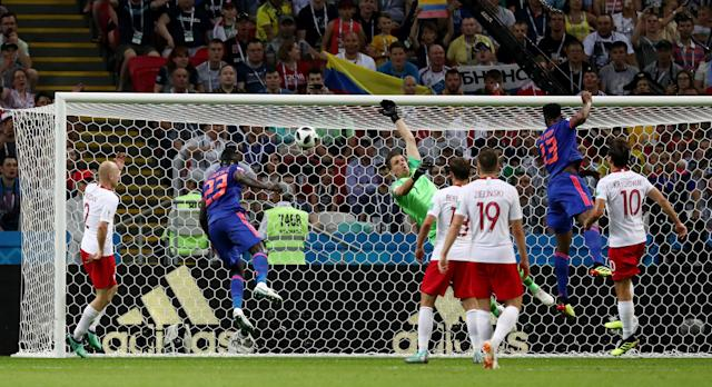 Soccer Football - World Cup - Group H - Poland vs Colombia - Kazan Arena, Kazan, Russia - June 24, 2018 Colombia's Yerry Mina scores their first goal REUTERS/Sergio Perez