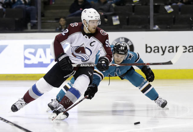 Colorado Avalanche's Gabriel Landeskog, left, is defended by San Jose Sharks' Tomas Hertl during the second period of an NHL hockey game Thursday, April 5, 2018, in San Jose, Calif. (AP Photo/Marcio Jose Sanchez)