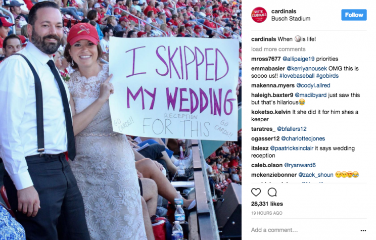 These Cardinals fans skipped out on their wedding reception. (Screenshot via @cardinals on Instagram)