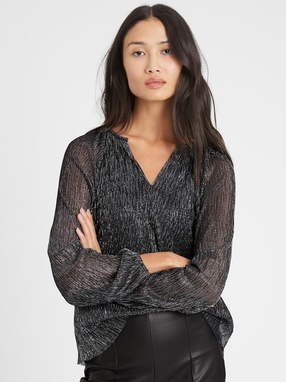 <p>This <span>Banana Republic Metallic Balloon-Sleeve Top</span> ($26) is the style that you get to add a little umph for a night out!</p>