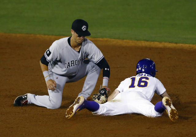 LSU's Brandt Broussard (16) beats the tag from South Carolina shortstop George Callil as he slides into second base during the second inning of a Southeastern Conference tournament NCAA college baseball game Tuesday, May 21, 2019, in Birmingham, Ala. (AP Photo/Butch Dill)