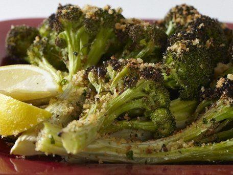 """<strong>Get the <a href=""""http://www.huffingtonpost.com/2011/10/27/oven-roasted-broccoli-wit_n_1057262.html"""" rel=""""nofollow noopener"""" target=""""_blank"""" data-ylk=""""slk:Oven-Roasted Broccoli with Spicy Breadcrumbs & Parmesan"""" class=""""link rapid-noclick-resp"""">Oven-Roasted Broccoli with Spicy Breadcrumbs & Parmesan</a> recipe</strong>"""