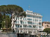 """A noble hospitality heritage meets guests' contemporary needs and desires (and the occasional fantasy) at Grand Hotel Miramare, a luxury hotel in Santa Margherita Ligure a short way from Portofino and <a href=""""https://www.cntraveler.com/story/cinque-terres-most-beloved-hiking-trail-will-re-open-after-an-11-year-closure?mbid=synd_yahoo_rss"""" rel=""""nofollow noopener"""" target=""""_blank"""" data-ylk=""""slk:Cinque Terre"""" class=""""link rapid-noclick-resp"""">Cinque Terre</a>. The Art Nouveau building gleams white in the sun amid century-old gardens. But for all of the grandeur, what most seduces are the intimate and almost down-home touches. Owner Andrea Fustinoni affectionately calls the hotel the Mira, which speaks to the feeling of being welcomed into a private residence. Each of the 36 deluxe rooms has a sea view, while the 26 superior rooms all have balconies or patios overlooking the hotel's gardens as they rise toward the foothills of Mount Portofino."""
