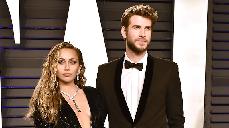 Miley Cyrus and Liam Hemsworth on red carpet