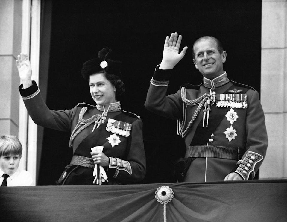 <p>Queen Elizabeth and the Duke of Edinburgh waving from balcony at Buckingham Palace during the 1979 Trooping The Colour.</p>