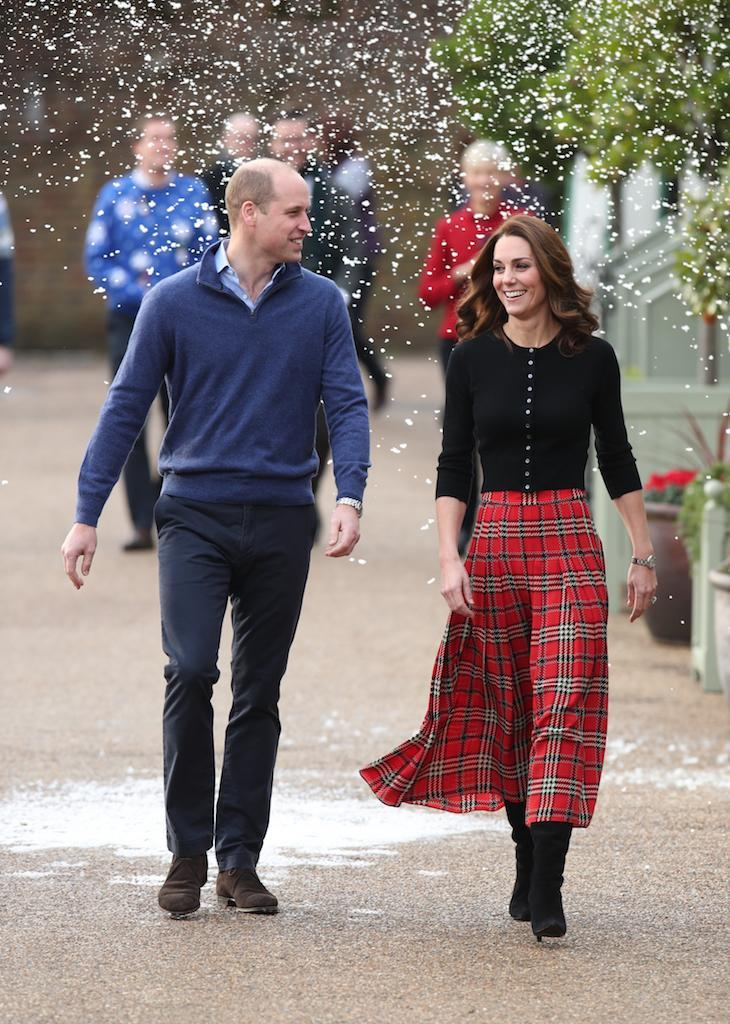 <p>One of the Duchess of Cambridge's final looks of 2018 is hands down our favourite. For a Christmas party at Kensington Palace on December 4, the 37-year-old chose an old-season tartan midi skirt by Emilia Wickstead. She finished the festive outfit with a buttoned £209 Brora cardigan. <em>[Photo: Getty]</em> </p>
