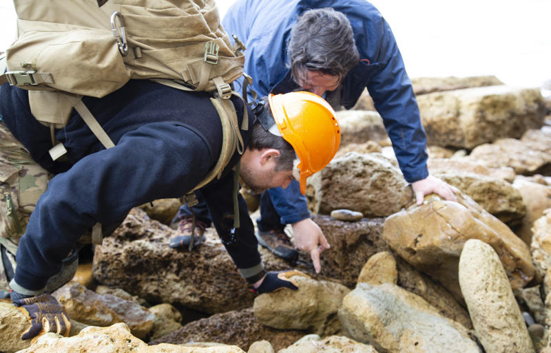 Paleontologist Dr Erich Fitzgerald and Phillip Mullalyand at the Jan Juc beach where the shark tooth fossil was found.