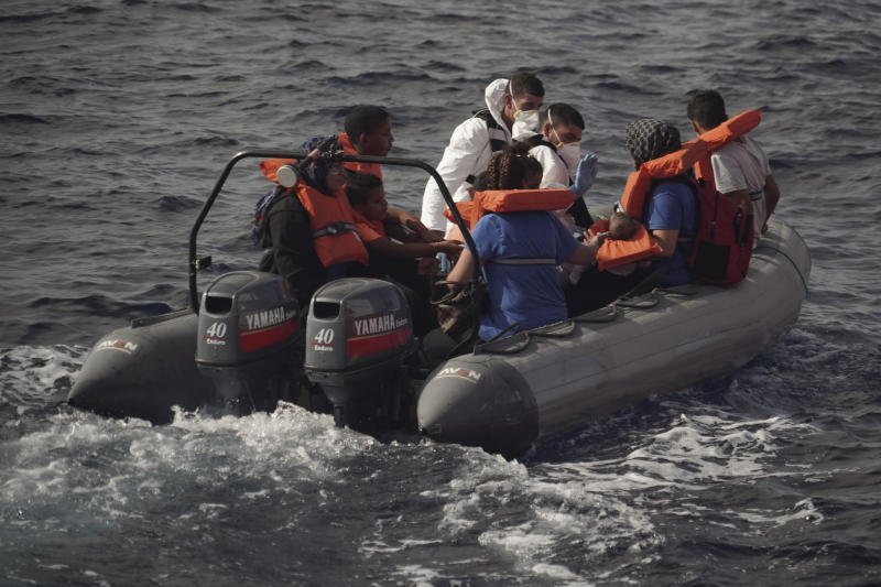 Members of the Maltese Armed Forces take a group of migrants to a Maltese military ship in the Mediterranean Sea, Friday, Sept. 20, 2019. Malta has agreed to take in 35 migrants fleeing Libya who were rescued by the Ocean Viking humanitarian ship a day earlier. (AP Photo/Renata Brito)