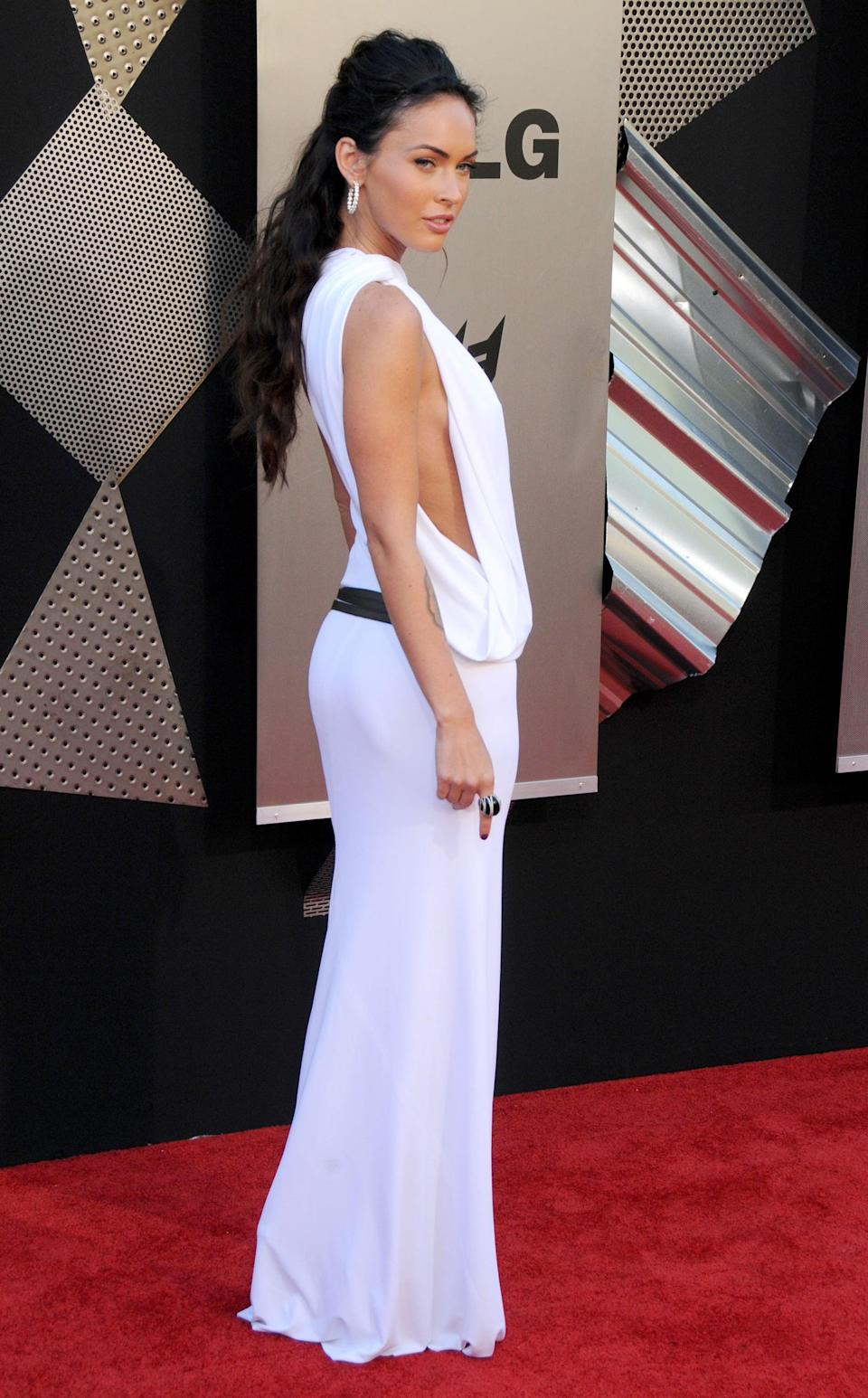 <p>Megan once again chose Kaufman Franco for the LA <b>Transformers</b> premiere, this time opting for a white dress featuring a side slit. </p>