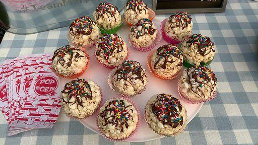 """<p>You can never have too much popcorn, and these pre-made popcorn balls are so easy to decorate and serve. Another easy way to serve snacks with minimal germ exposure since there won't be a bunch of kids grabbing into a giant tin of buttery goodness. Decorate with milk or white chocolate, sprinkles, and more. </p><p><strong>What You'll Need: </strong><a href=""""https://go.redirectingat.com?id=74968X1596630&url=https%3A%2F%2Fwww.thepopcornfactory.com%2Fpopcorn-balls-by-the-box&sref=https%3A%2F%2Fwww.womansday.com%2Flife%2Fg33216073%2Fdiy-movie-night%2F"""" rel=""""nofollow noopener"""" target=""""_blank"""" data-ylk=""""slk:Popcorn balls"""" class=""""link rapid-noclick-resp"""">Popcorn balls </a>($35 for 24, The Popcorn Factory); <a href=""""https://www.amazon.com/Cupcake-Rainbow-Baking-Wedding-Birthday/dp/B07Y2BVHRQ/ref=sr_1_2?dchild=1&keywords=cupcake+wrappers&qid=1594070232&sr=8-2&tag=syn-yahoo-20&ascsubtag=%5Bartid%7C10070.g.33216073%5Bsrc%7Cyahoo-us"""" rel=""""nofollow noopener"""" target=""""_blank"""" data-ylk=""""slk:Cupcake wrappers"""" class=""""link rapid-noclick-resp"""">Cupcake wrappers </a>($9 for 100, Amazon)</p>"""