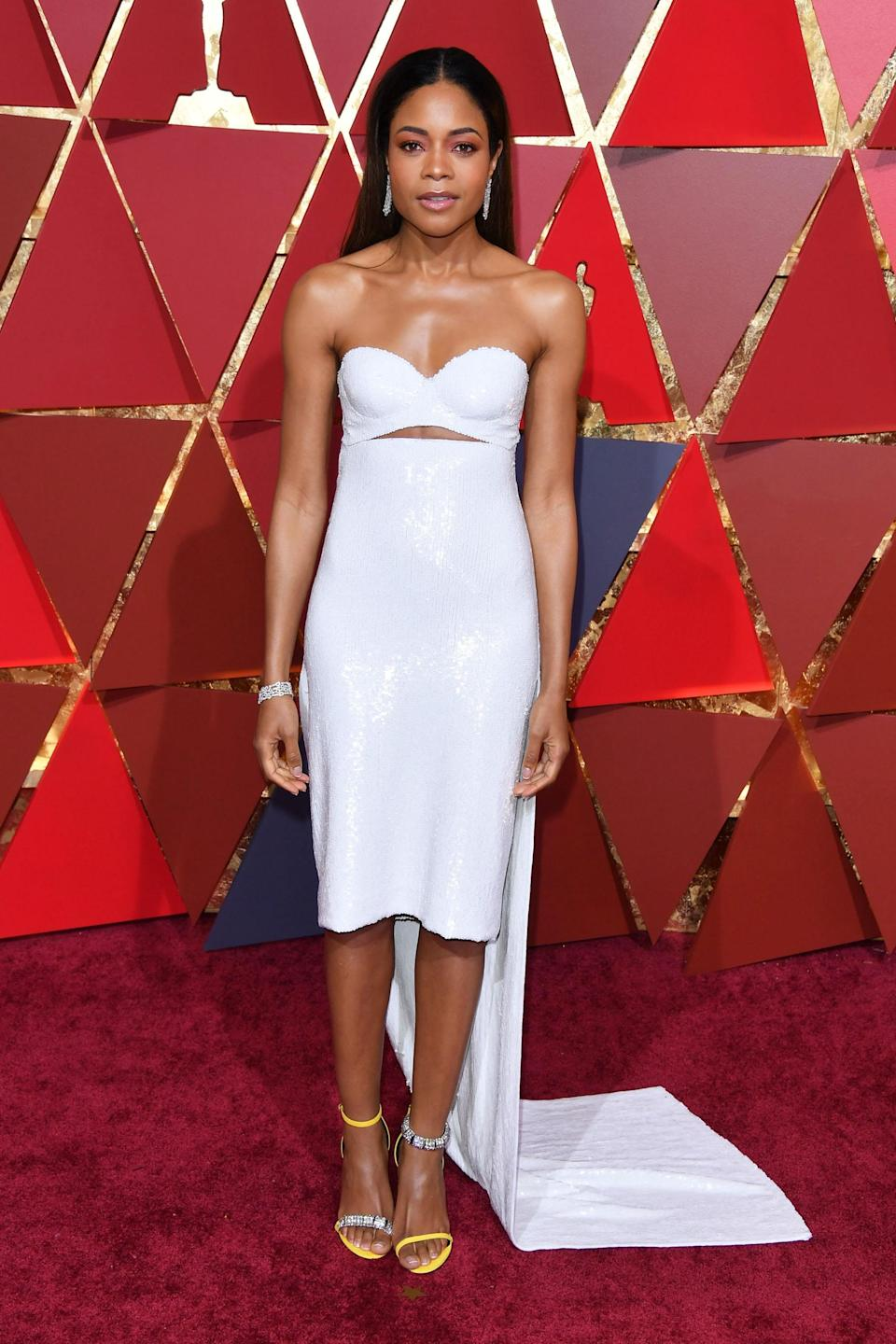 """<h2>Naomie Harris, 2017</h2><br>Of the four <em>Moonlight</em> stars dressed by Raf Simons for Calvin Klein, this white sequin frock on Naomie Harris took home the prize (for best-dressed) in our book.<br><br><em>Naomie Harris in Raf Simons for Calvin Klein.</em><span class=""""copyright"""">Photo: George Pimentel/FilmMagic/Getty Images.</span>"""