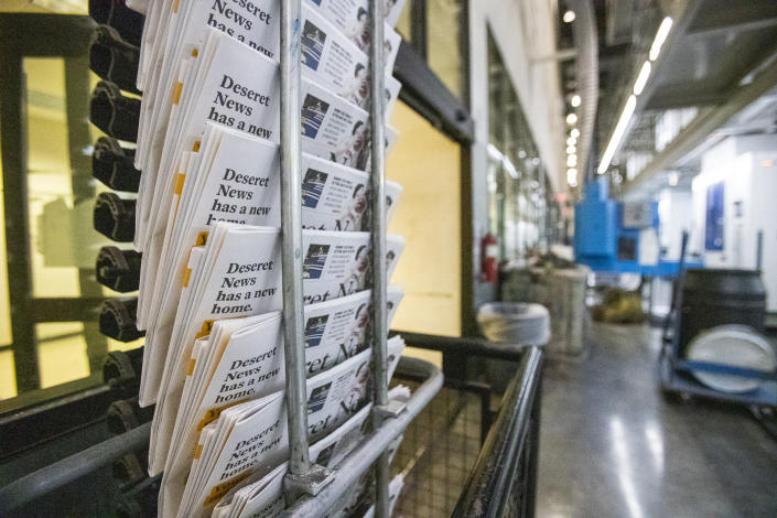 Copies of the last daily edition of the Deseret News move along the wrack at the MediaOne building in West Valley City, Utah, on Wednesday, Dec. 30, 2020. Both of Salt Lake City's major newspapers released their final daily print editions Thursday as the two publications transition to weekly editions. The Salt Lake Tribune, which won the Pulitzer Prize for local reporting in 2017, will continue to publish breaking stories online every day. The 170-year-old Deseret News in the state capital will also shift its attention online and offer a monthly magazine which will debut in January. (Scott G Winterton/The Deseret News via AP)