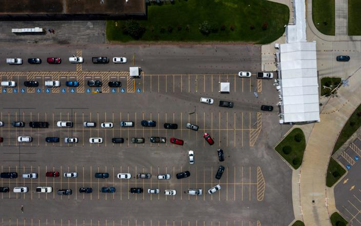 Residents line-up in their vehicles to be tested in Houston, Texas - REUTERS/Adrees Latif