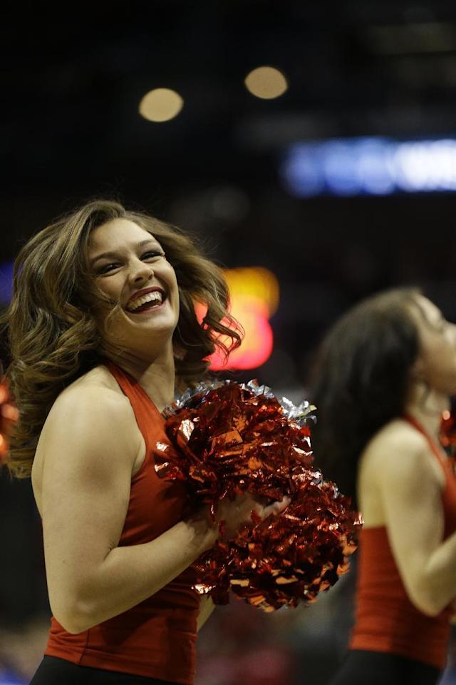 Wisconsin cheerleaders perform during the first half of a second-round game in the NCAA college basketball tournament Thursday, March 20, 2014, in Milwaukee. (AP Photo/Jeffrey Phelps)