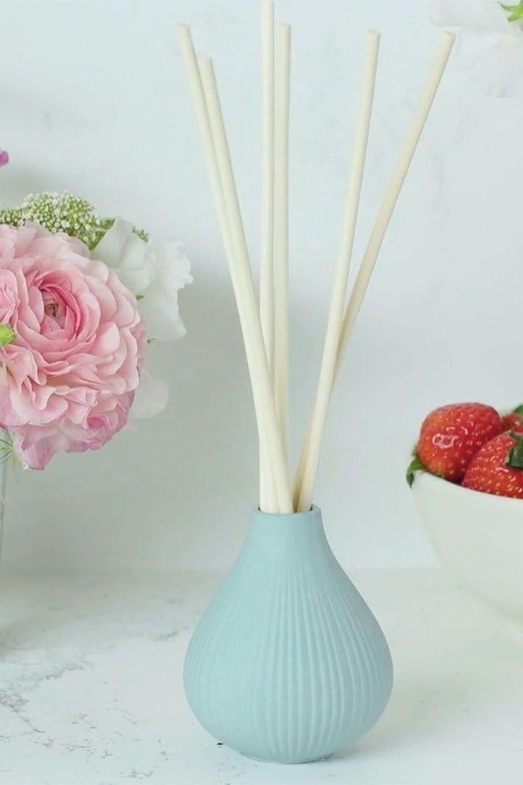 """<p>If your mom loves to have a signature scent in her home, make her dreams come true with a customizable reed diffuser that will have her space smelling fresh all the time.</p><p><strong><em>Get the tutorial at <a href=""""https://www.goodhousekeeping.com/home/a30730962/homemade-reed-diffuser/"""" rel=""""nofollow noopener"""" target=""""_blank"""" data-ylk=""""slk:Good Housekeeping"""" class=""""link rapid-noclick-resp"""">Good Housekeeping</a>.</em></strong></p><p><strong><a class=""""link rapid-noclick-resp"""" href=""""https://www.amazon.com/Modern-Ceramic-Decorative-Tabletop-Centerpiece/dp/B01CKNH3ZY/ref=sr_1_12?dchild=1&keywords=small+vase&qid=1605819983&s=home-garden&sr=1-12&tag=syn-yahoo-20&ascsubtag=%5Bartid%7C10063.g.34832092%5Bsrc%7Cyahoo-us"""" rel=""""nofollow noopener"""" target=""""_blank"""" data-ylk=""""slk:SHOP SMALL VASES"""">SHOP SMALL VASES</a></strong></p>"""