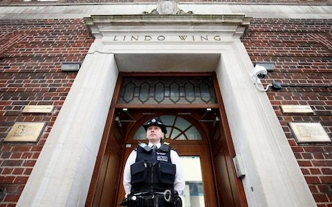 A police officer stands outside the Lindo Wing - Credit: HENRY NICHOLLS/Reuters