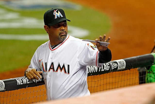 MIAMI, FL - APRIL 04: Manager Ozzie Guillen #13 of the Miami Marlins waves during Opening Day against the St. Louis Cardinals at Marlins Park on April 4, 2012 in Miami, Florida. (Photo by Mike Ehrmann/Getty Images)