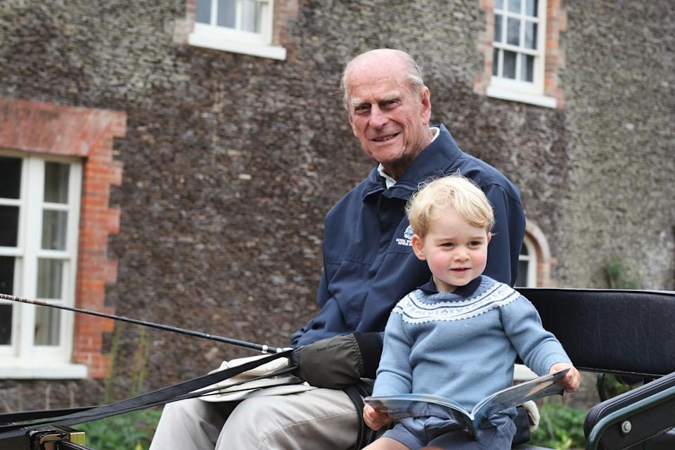 The tribute was shared alongside a previously unreleased photograph of a young Prince George with his great-grandfather Philip (Kensington Palace)