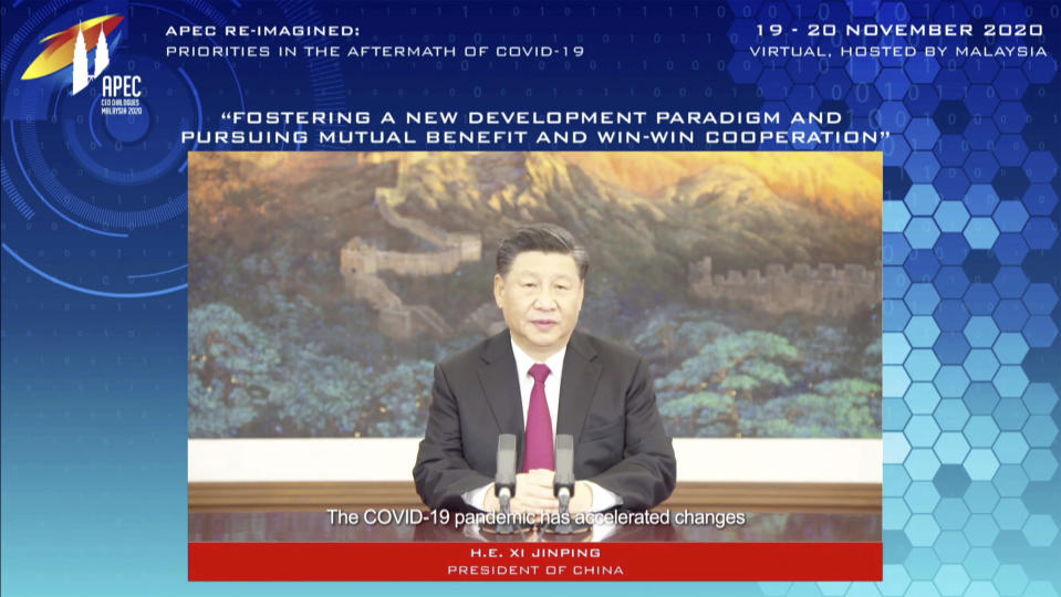 In this image from video released by APEC CEO Dialogues Malaysia 2020, China's President Xi Jinping, speaks at a CEO Dialogue forum via video link, ahead of the Asia-Pacific Economic Cooperation (APEC) leaders' summit, hosted by Malaysia, in Kuala Lumpur, Malaysia, Thursday, Nov. 19, 2020. (APEC CEO Dialogues Malaysia 2020 via AP)