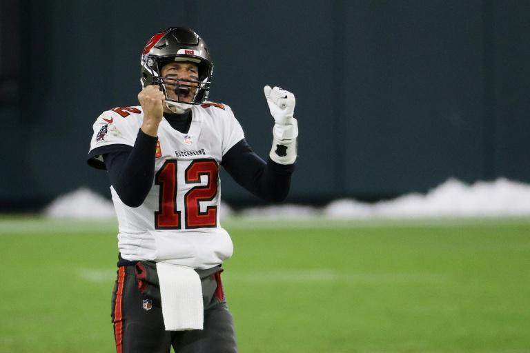 Tom Brady celebrates after the Tampa Bay Buccaneers book their place in the Super Bowl after an upset of the Green Bay Packers