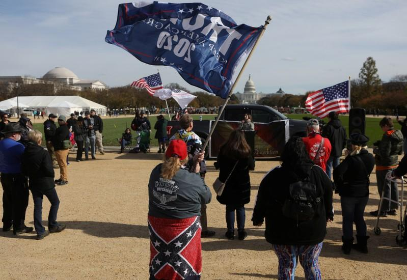 """Militia members and pro-gun rights activists participating in the """"Declaration of Restoration"""" rally listen to speakers in Washington, D.C."""