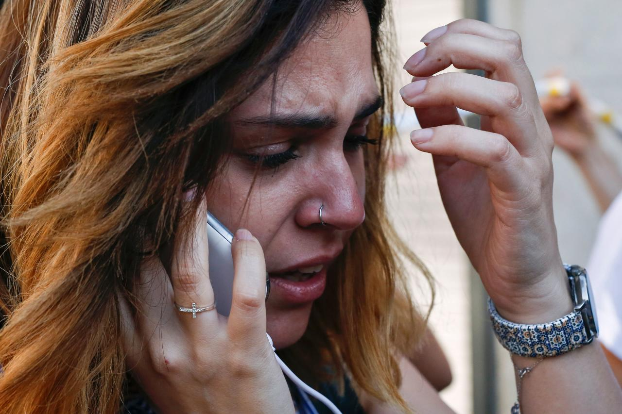 <p>A woman cries as she phones after a van ploughed into the crowd, killing one person and injuring several others on the Rambla in Barcelona on August 17, 2017. (Pau Barrena/AFP/Getty Images) </p>
