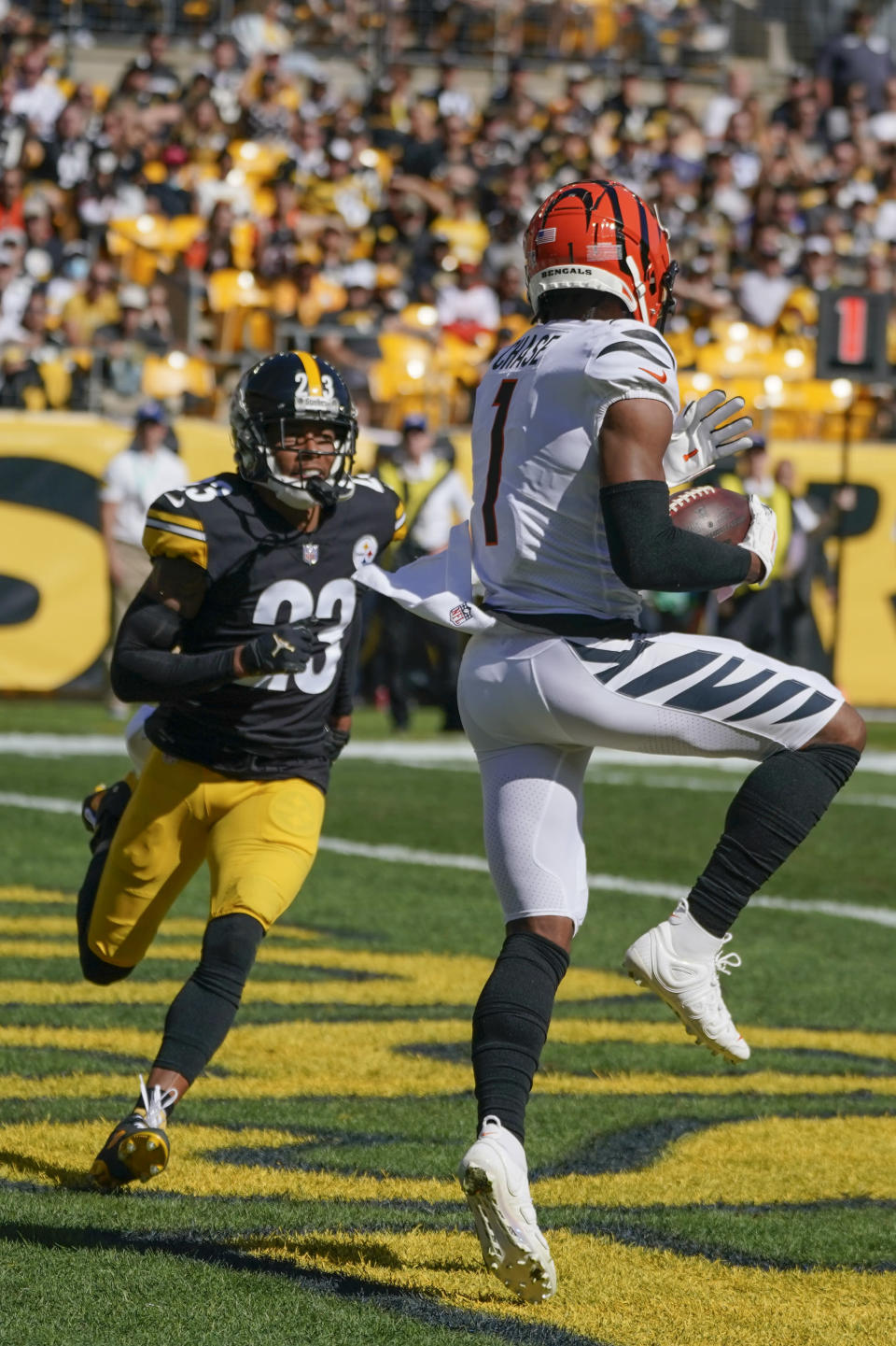 Cincinnati Bengals wide receiver Ja'Marr Chase (1) catches a touchdown pass in front of Pittsburgh Steelers cornerback Joe Haden (23) during the second half an NFL football game, Sunday, Sept. 26, 2021, in Pittsburgh. (AP Photo/Gene J. Puskar)