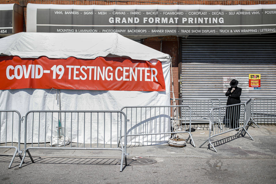 A COVID-19 testing tent is setup on a sidewalk in a predominantly Ultra-Orthodox neighborhood in the Brooklyn borough of New York, Friday, March 27, 2020. The new coronavirus causes mild or moderate symptoms for most people, but for some, especially older adults and people with existing health problems, it can cause more severe illness or death. (AP Photo/John Minchillo)