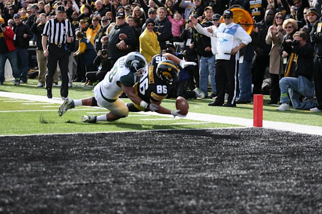 IOWA CITY, IA - NOVEMBER 12: C. J. Fiedororowics #86 of the Iowa Hawkeyes is tackled by Denicos Allen #28 of the Michigan State Spartans at Kinnick Stadium November 12, 2011 in Iowa City, Iowa. (Photo by Reese Strickland/Getty Images)