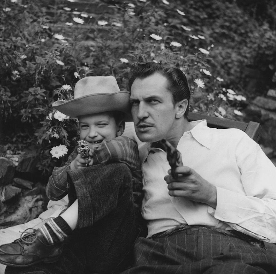 <p>The horror actor, star of <em>House of Wax</em> and <em>House on Haunted Hill</em>, relaxes with his son in the yard of his Beverly Hills home, circa 1946.</p>