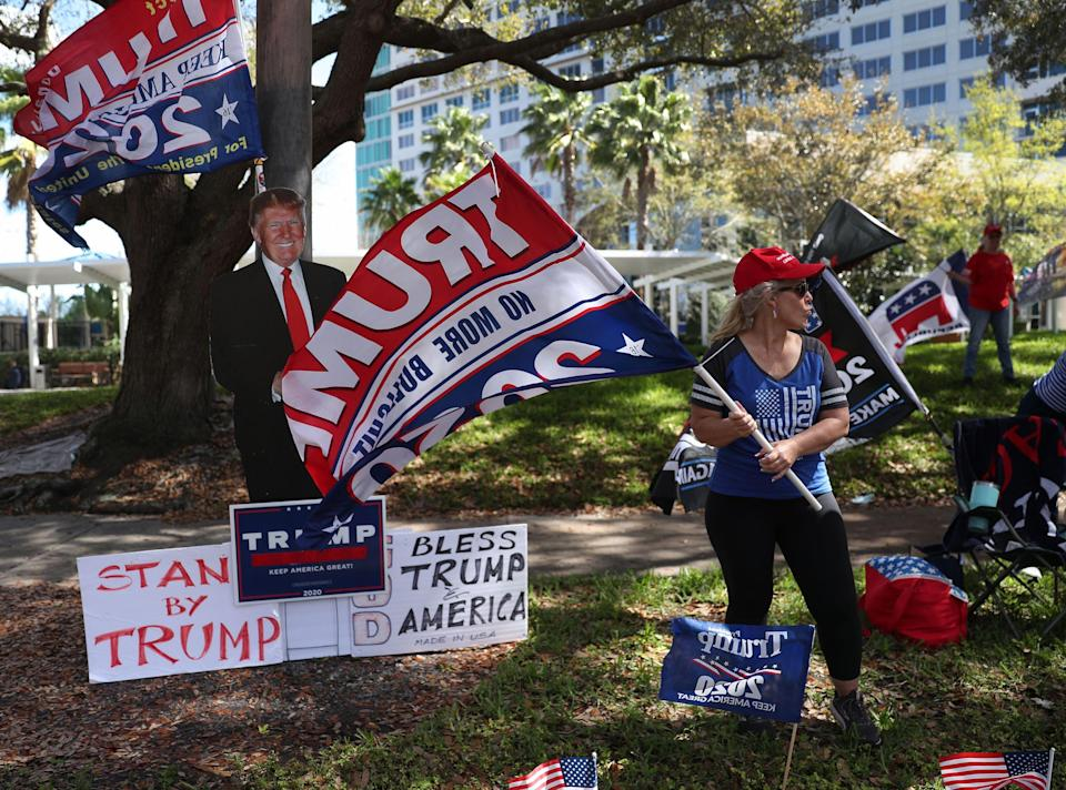 Before he took the stage inside at the Conservative Political Action Conference, supporters of former President Donald Trump stood outside the Hyatt Regency on Sunday. (Photo: Joe Raedle/Getty Images)
