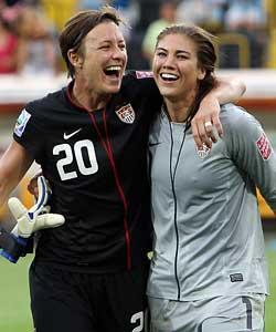 Abby Wambach (left) got the tying goal and Hope Solo made a crucial save during penalty kicks to lift the USA