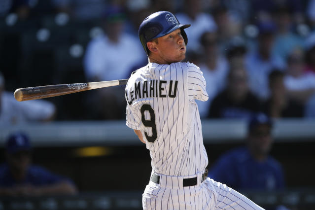 "<a class=""link rapid-noclick-resp"" href=""/mlb/teams/colorado/"" data-ylk=""slk:Colorado Rockies"">Colorado Rockies</a>' D.J. LeMahieu in the third inning of a baseball game Sunday, Sept. 27, 2015, in Denver. (AP Photo/David Zalubowski)"