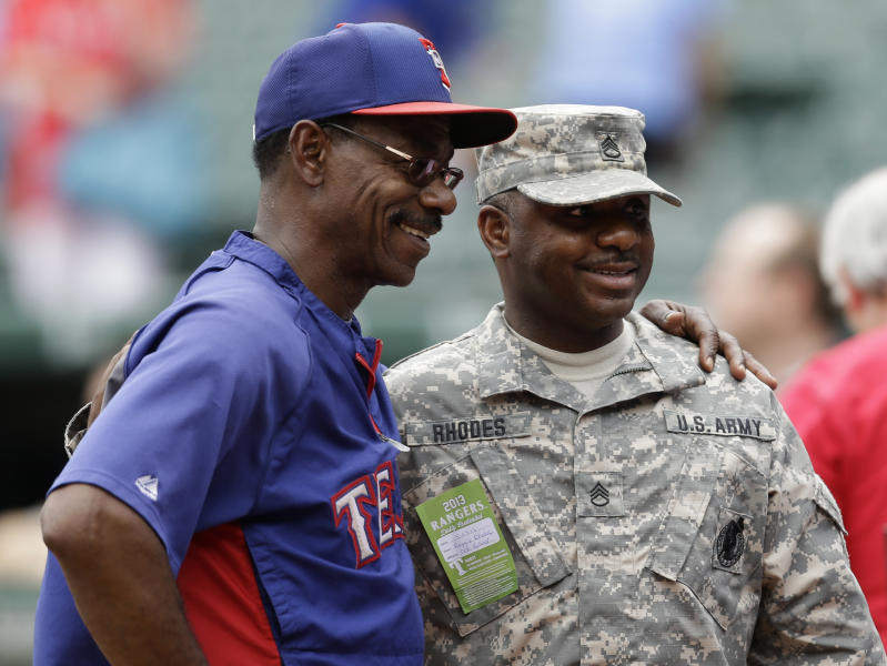 Texas Rangers manager Ron Washington, left, poses for a photo with United States Army Staff Sgt. Reggie Rhodes, of the McKinney, Texas, recruiting station, as the Rangers take batting practice before a baseball game against the Arizona Diamondbacks, Wednesday, May 29, 2013, in Arlington, Texas. (AP Photo/Tony Gutierrez)