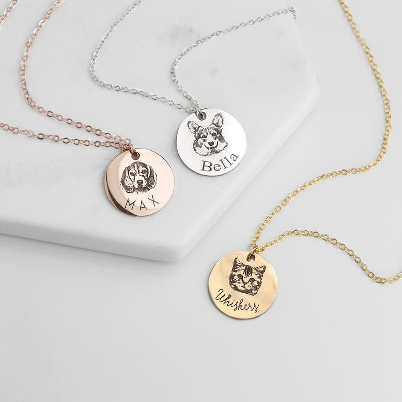 """<p><strong>MignonandMignon</strong></p><p>etsy.com</p><p><strong>$27.99</strong></p><p><a href=""""https://go.redirectingat.com?id=74968X1596630&url=https%3A%2F%2Fwww.etsy.com%2Flisting%2F662878169%2Fpet-portrait-necklaces-personalized&sref=https%3A%2F%2Fwww.seventeen.com%2Flife%2Ffriends-family%2Fg30140775%2Fgifts-for-mom-from-daughter%2F"""" rel=""""nofollow noopener"""" target=""""_blank"""" data-ylk=""""slk:Shop Now"""" class=""""link rapid-noclick-resp"""">Shop Now</a></p><p>This Etsy shop will engrave a portrait of her favorite child (AKA your dog) on a sleek pendant. </p>"""