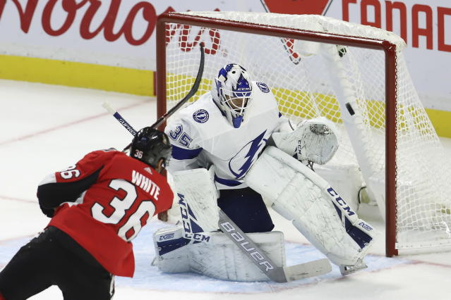 Ottawa Senators centre Colin White (36) shoots and scores on Tampa Bay Lightning goaltender Curtis McElhinney (35) during second period of NHL hockey action in Ottawa, Saturday, October 12, 2019. THE CANADIAN PRESS/Fred Chartrand/The Canadian Press via AP)