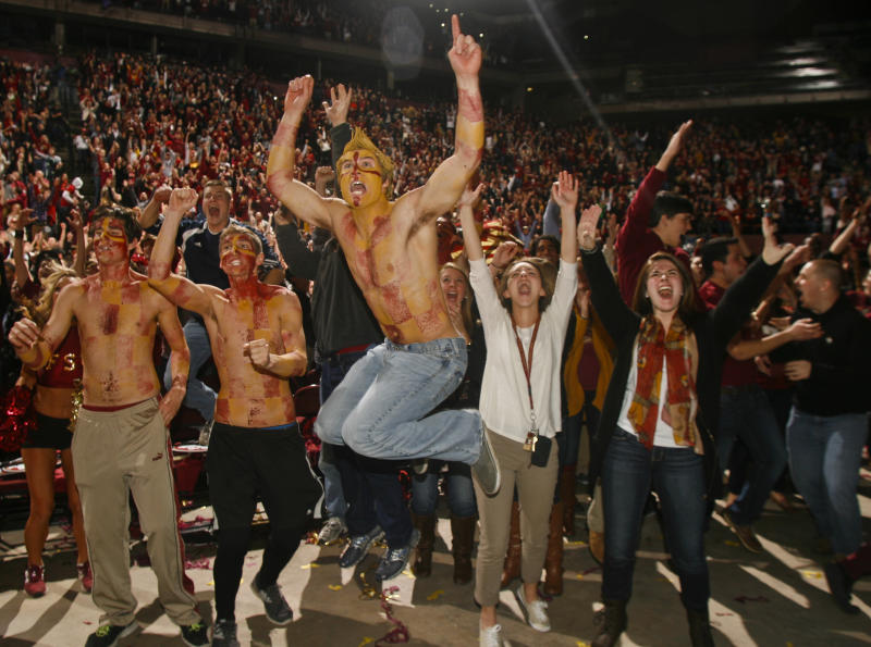 Florida State fans react as they watch a touchdown in the final seconds of the BCS Championship football game between Florida State and Auburn on a 30-foot screen at the Tallahassee Leon County Civic Center on Monday, Jan. 6, 2014, in Tallahassee, Fla. Florida State beat Auburn 34-31. (AP Photo/Phil Sears)