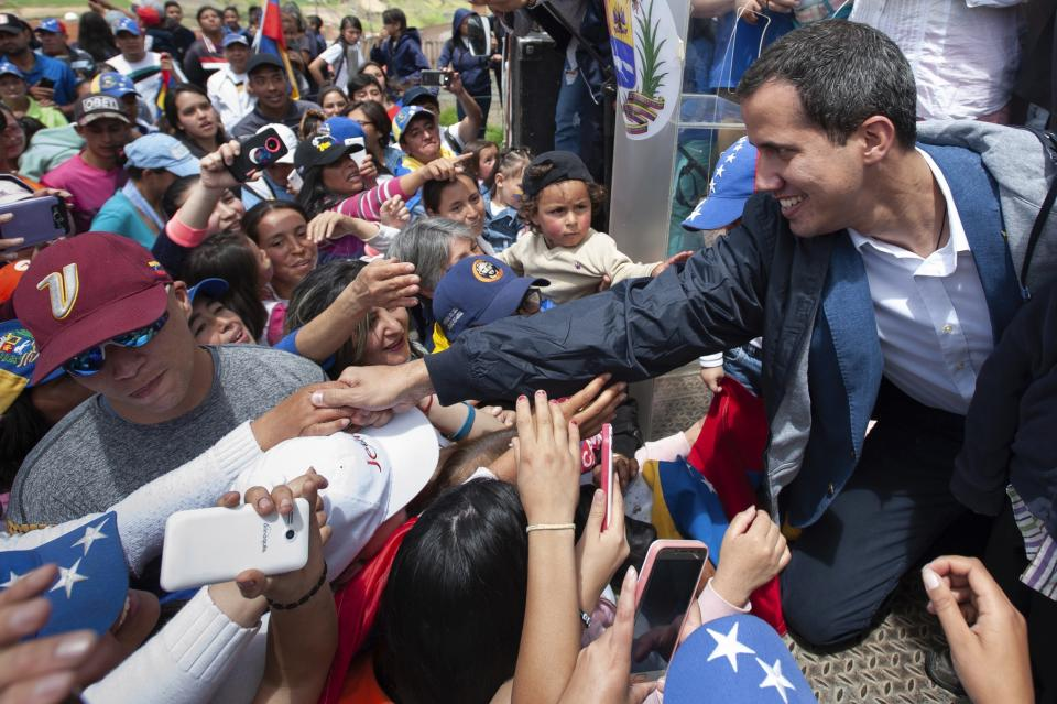 In this photo provided by the Juan Guaido press office, Venezuela's opposition leader and self-proclaimed interim President Juan Guaido greets supporters during a rally in Mucuchies, Merida state, Venezuela, Thursday, June 13, 2019. Guaidó has channeled the frustrations of angry Venezuelans suffering from food shortages made worse by punishing U.S. oil sanctions but has been unable to weaken President Nicolás Maduro's grip on power and sway over the all-power military. (Josibeth Lanza/Juan Guaido's press office via AP)