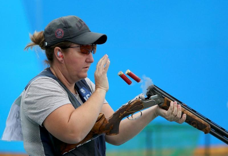Kim Rhode discharges shells from her rifle duing woman's skeet qualifications. (Reuters)