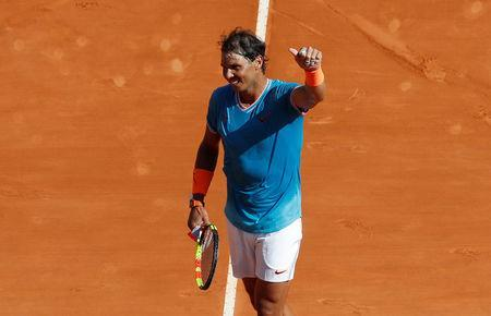 Tennis - ATP 1000 - Monte Carlo Masters - Monte-Carlo Country Club, Roquebrune-Cap-Martin, France - April 17, 2019 Spain's Rafael Nadal celebrates after winning his second round match against Spain's Roberto Bautista Agut REUTERS/Eric Gaillard