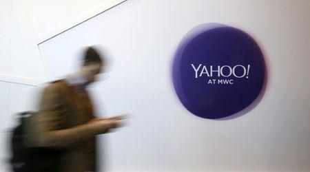 File photo of a man walking past a Yahoo logo during the Mobile World Congress in Barcelona