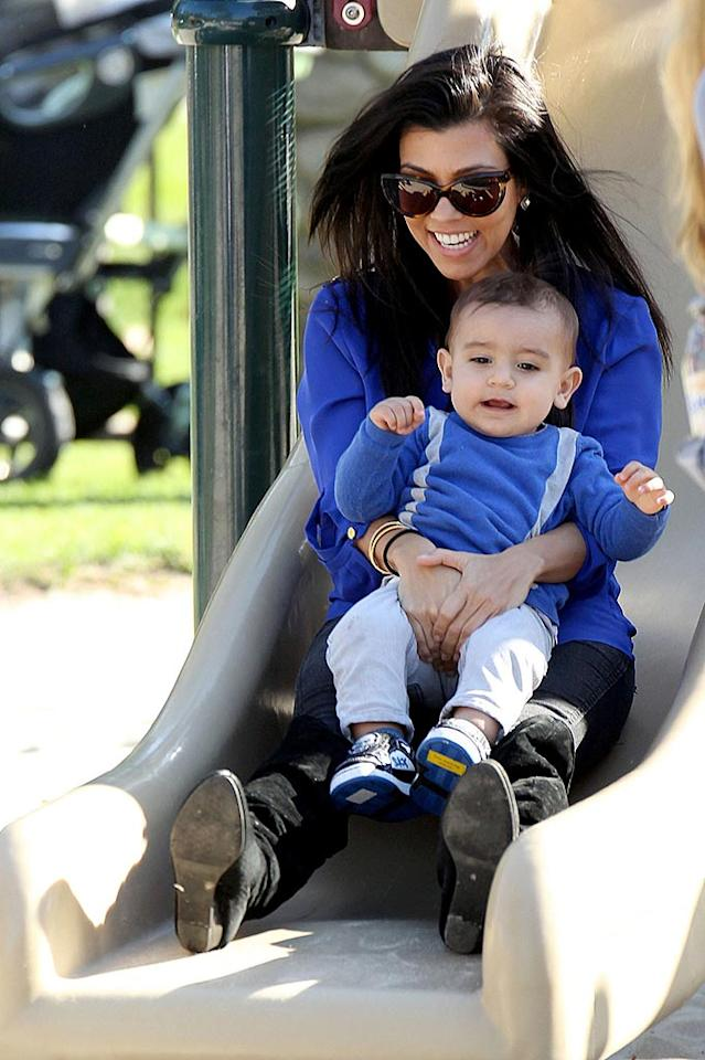 """Kourtney Kardashian may be taking New York with sister Kim on her new show, but her most important role is still mom to tiny Mason. The 31-year-old took a ride down a slide with her tot in Los Angeles on Saturday. Pedro Andrade/Sam Sharma/<a href=""""http://www.pacificcoastnews.com/"""" target=""""new"""">PacificCoastNews.com</a> - January 22, 2011"""