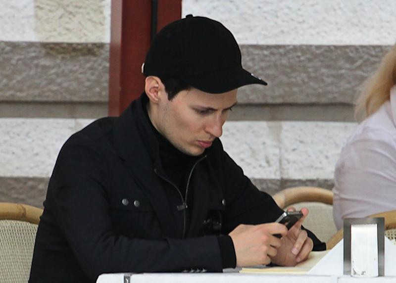 "In this photo taken Saturday, May 19, 2012, Pavel Durov, founder of Russia's leading social network site VKontakte, or ""in contact"", sits in a cafe in Red Square in Moscow, Russia. Creator of Russia's leading social network Durov left his post as CEO on Tuesday April 22, 2014, and is understood to have left Russia, one week after he posted online what he said were documents from the security services demanding personal details from 39 Ukraine-linked groups on VKontakte.(AP Photo/Roman Kulik)"